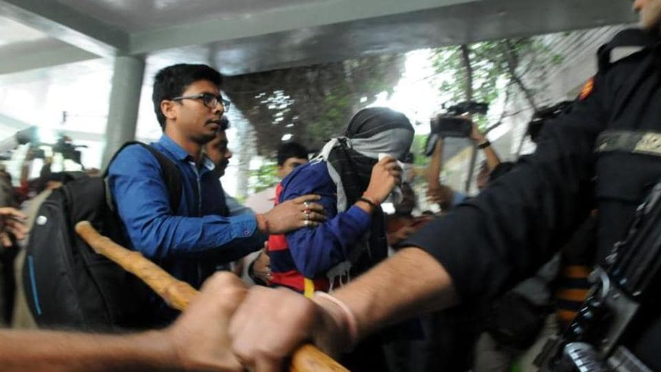 The CBI produces a Class 11 student (face covered) of Ryan International School in a juvenile court, in Gurgaon on Wednesday. (Parveen Kumar/HTPhoto)