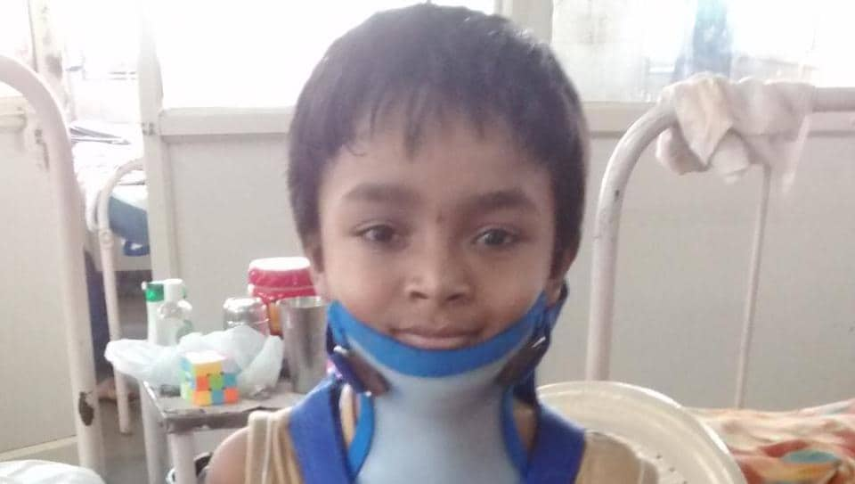 Charan is now able to walk and move his head, with support of a neck brace, but will need physiotherapy for the next three months.