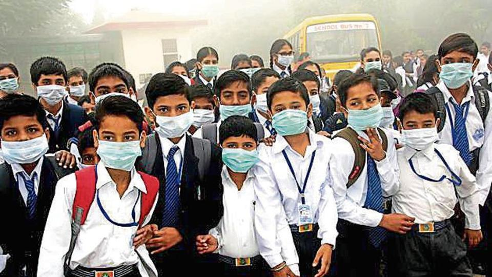 Students of a school wearing mask to protect themselves from pollution in Rohtak on Wednesday.