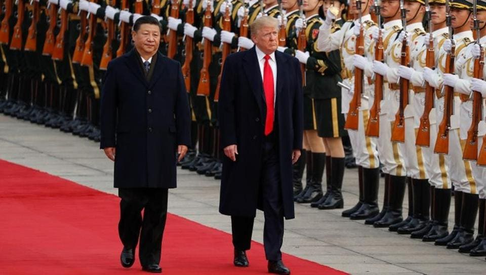 US President Donald Trump takes part in a welcoming ceremony with China's President Xi Jinping in Beijing, China on November 9.