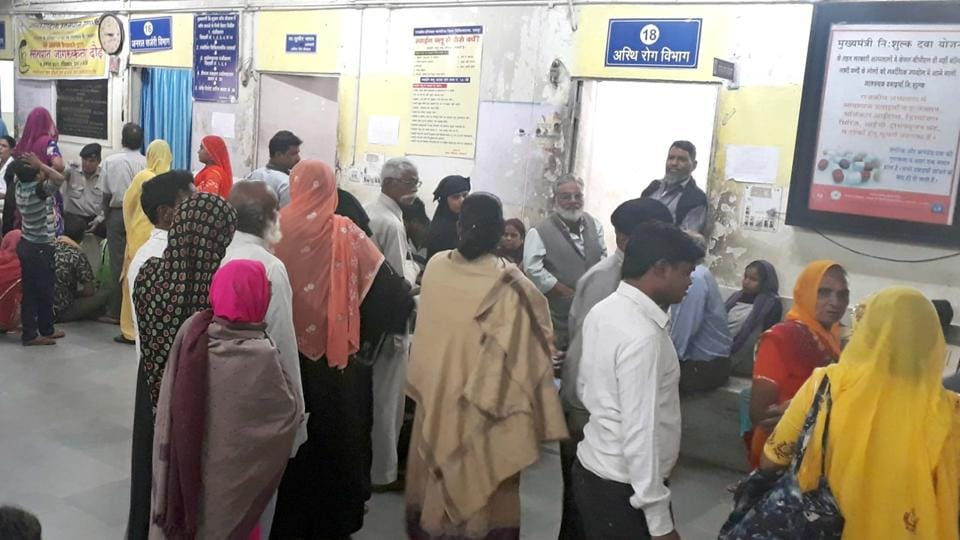 Queues out side doctors' chambers at a government hospital in Jaipur.