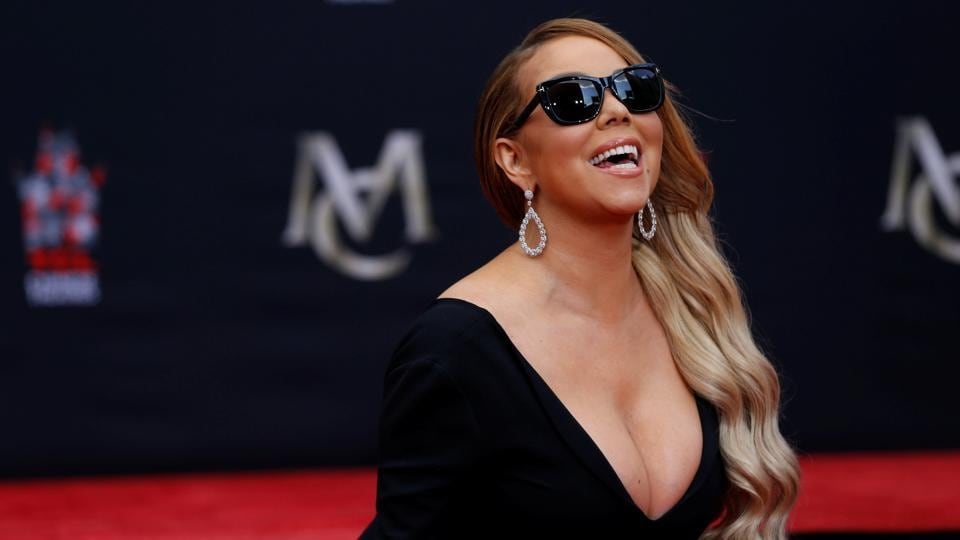 Singer Mariah Carey poses at a ceremony for placing her handprints and footprints in cement in the forecourt of the TCL Chinese theatre in Los Angeles.