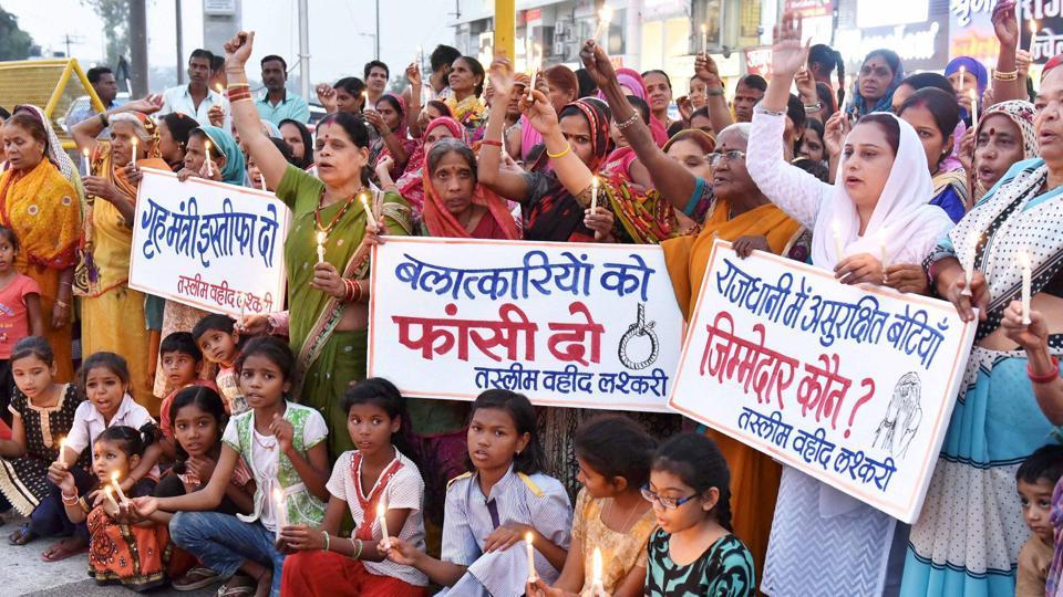 Congress activists and children take part in a protest against the alleged gangrape of a student in Bhopal.
