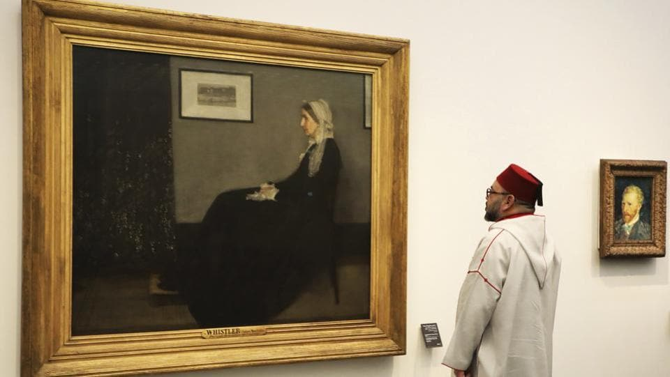 "Moroccan King Mohammed VI looks at a painting titled ""Whistler's Mother"" by James Abbott McNeill Whistler (1871) as he visits the Louvre Abu Dhabi Museum during its inauguration. The museum is displaying more than 235 works of art from the Emirati collection, including Edouard Manet's ""The Gypsy"" and works by Dutch abstract artist Piet Mondrian and Turkey's Osman Hamdi Bey. (Ludovic Marin / Pool photo via AP)"