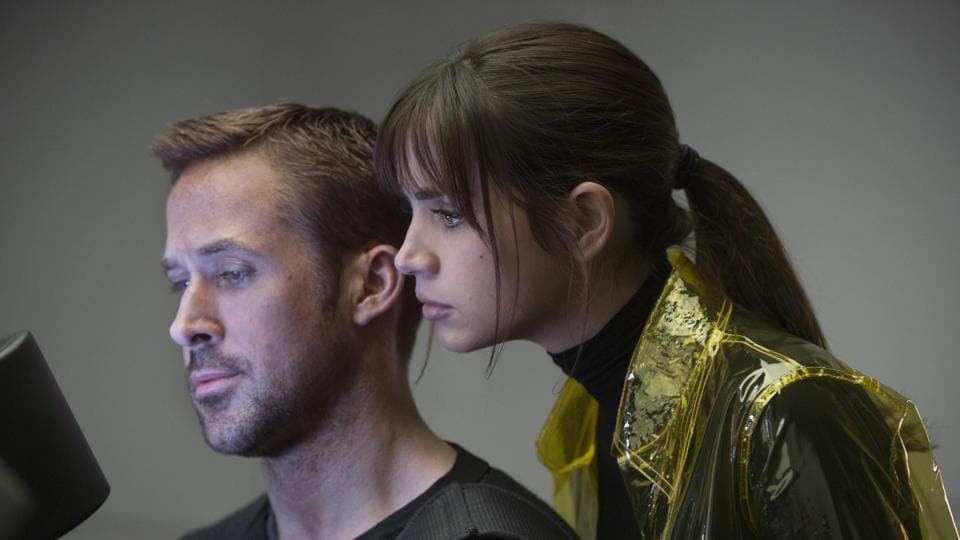 This image released by Warner Bros. Pictures shows Ryan Gosling, left, and Ana de Armas in a scene from Blade Runner 2049.