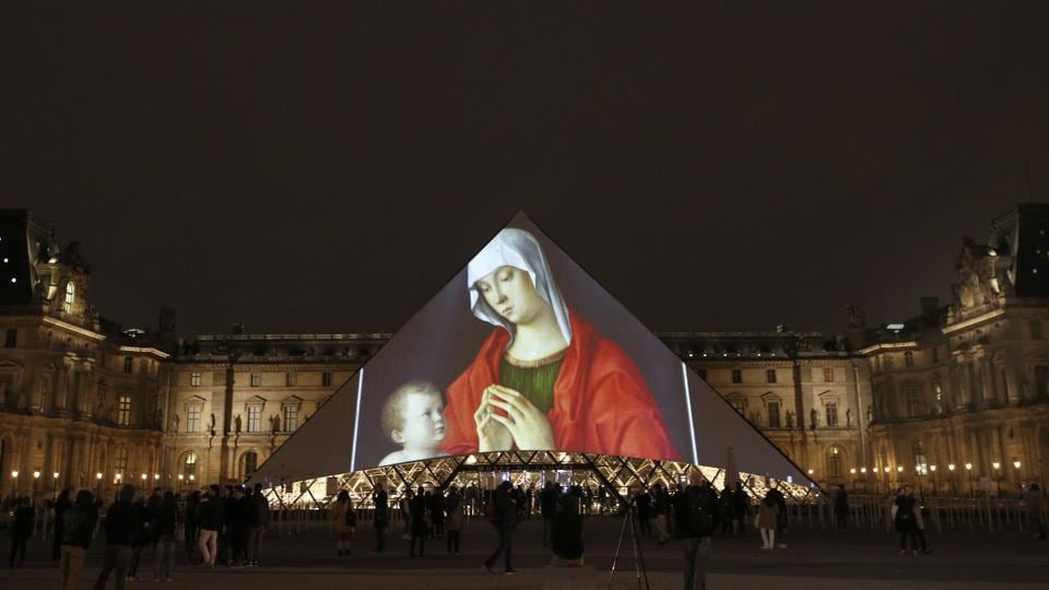 "Pictures are projected on the Pyramid of the Louvre in Paris, celebrating the opening of the Louvre Abu Dhabi. The museum expects to welcome around 5,000 visitors in the first few days following the public opening on November 11. Jean-Luc Martinez, president-director of the Louvre in Paris described it as a bridge between Asia, Africa and Europe. ""It's a place to see the world from Abu Dhabi."" (Christophe Ena / AP)"