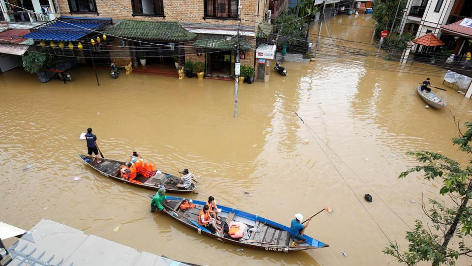The only mode of transport left in this submerged town are boats. The city, a 30-minute drive from where the pre-summit meetings are being held, suffered its worst flooding in nearly 20 years over the weekend as Typhoon Damrey hammered the area. (Kham / REUTERS)