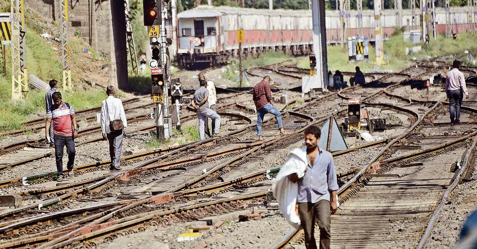 People illegally crossing railway tracks at Pune railway station on November 7. Though accidents due to trespassing have come down in recent years, a lot of people still prefer this illegal 'shortcut'.