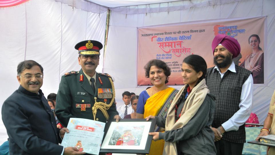 Neelam Negi is felicitated by IMA commandant Lt. Gen. Sanjay Kumar Jha and former Rajya Sabha MP Tarun Vijay in Dehradun on Thursday.