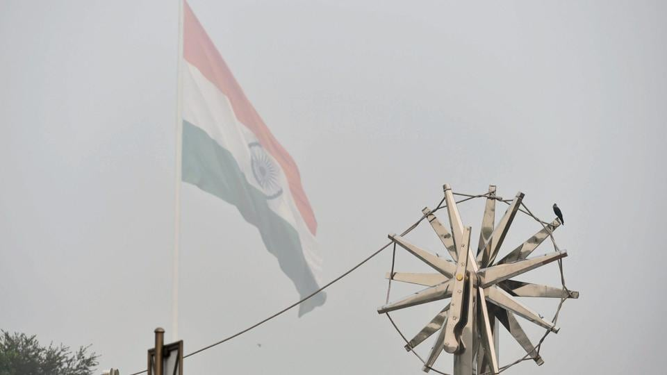 View of the steel 'Charkha'', installed at Rajiv Chowk, enveloped by heavy smog in New Delhi on Wednesday.