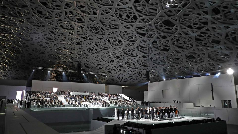 "The Louvre Abu Dhabi Museum designed by French architect Jean Nouvel seenduring its inauguration on Saadiyat island in the Emirati capital on November 08, 2017. More than a decade in the making, the ""Louvre in the sands"" opened its doors Wednesday, winning praise from French President Emmanuel Macron as a ""bridge between civilisations"" and religions. (Luovic Marin / AFP)"