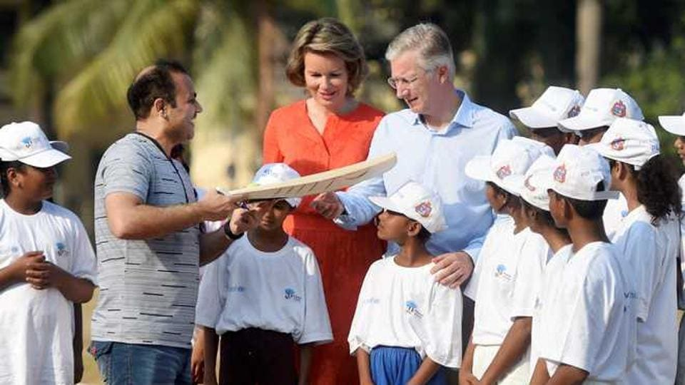 Virender Sehwag was seen at Mumbai's Oval Maidan, swinging the bat with school children. Also present were the Belgian Royal couple King Philippe and Queen Mathilde.