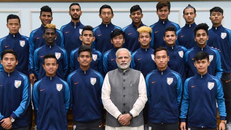 Narendra Modi poses with the Indian footballers who took part in the FIFA U-17 World Cup.