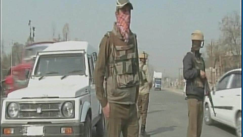 Security personnel on guard after militants fired at a police vehicle in Qazigund in Jammu and Kashmir. (ANI Twitter)