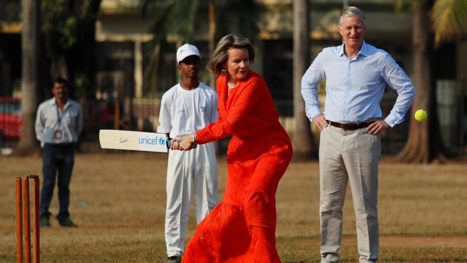 Belgium's King Philippe looks on as Queen Mathilde hits a ball as they play cricket with children in Mumbai on November 10, 2017. (Danish Siddiqui / REUTERS)