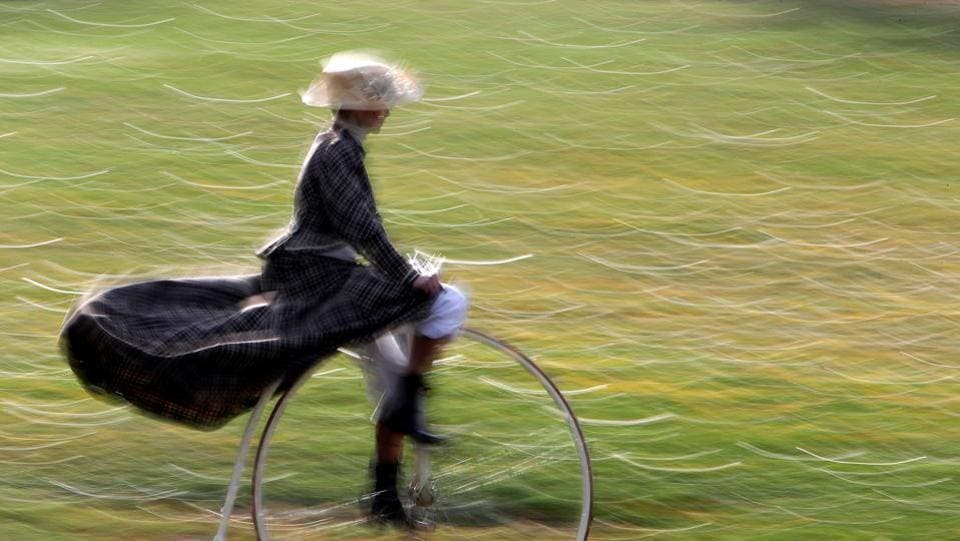 A woman paints a victorian picture riding her penny farthing bicycle before the annual penny farthing race in Prague, Czech Republic on November 4, 2017. (David W Cerny / REUTERS)
