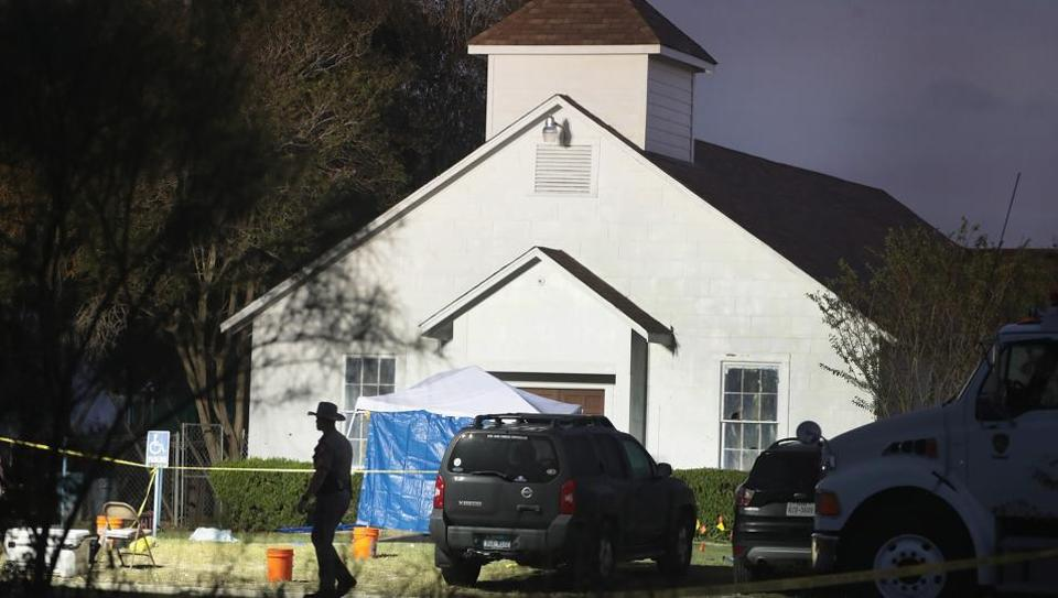 Law enforcement officials continue their investigation at Sutherland Springs Baptist Church in Texas