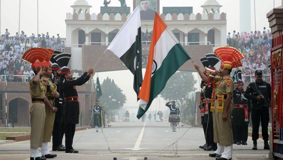 Pakistani Rangers and Indian Border Security Force personnel perform during the daily beating of the retreat ceremony at the India-Pakistan Wagah Border Post on October 30.