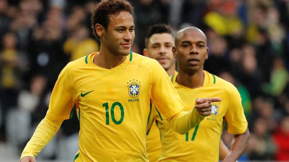 Brazil's Neymar celebrates scoring their first goal against Japan.