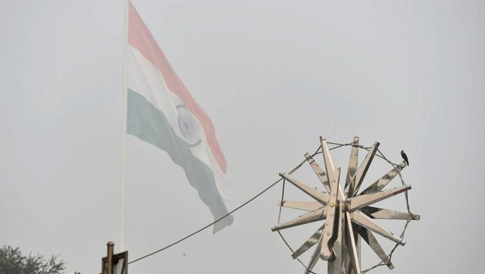 View of the steel ''Charkha'', installed at Rajiv Chowk, enveloped by heavy smog in New Delhi on Wednesday. The smog and air pollution continue to be above the severe levels in Delhi NCR.