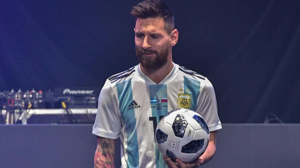 Lionel Messi poses with the official match ball for the 2018 World Cup during its unveiling ceremony in Moscow.