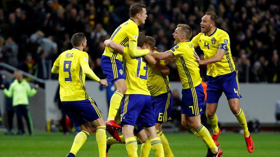 Sweden's Jakob Johansson celebrates scoring the only goal of their FIFAWorld Cup qualifier vs Italy with team mates.