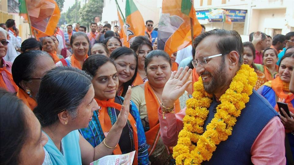 Union minister Prakash Javadekar interacts with people during door to door election campaigning for BJP for Gujarat assembly elections in Rajkot.