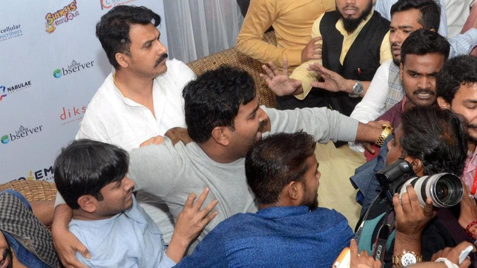 People shout slogans against former JNU students' union president Kanhaiya Kumar (L) during a function in Lucknow.