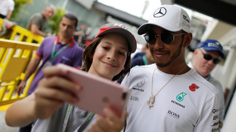 Mercedes' Lewis Hamilton of Britain poses for a selfie after second practice at the Brazilian GP