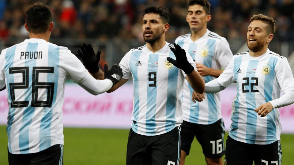 Argentina's Sergio Aguero celebrates scoring their first goal against Russia with Cristian Pavon and team mates.