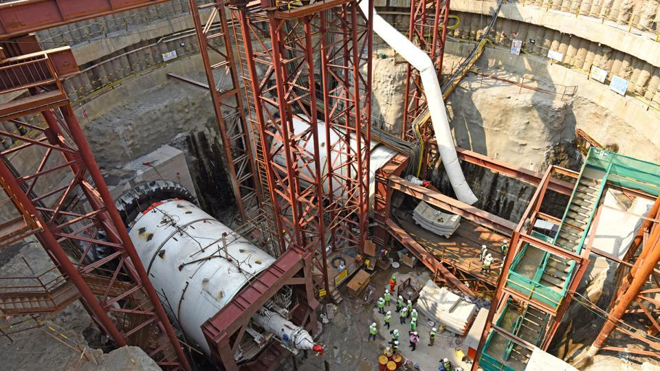 Workers assemble the left TBM and begin tunneling work with the right one at Naya Nagar in Mahim on Friday.