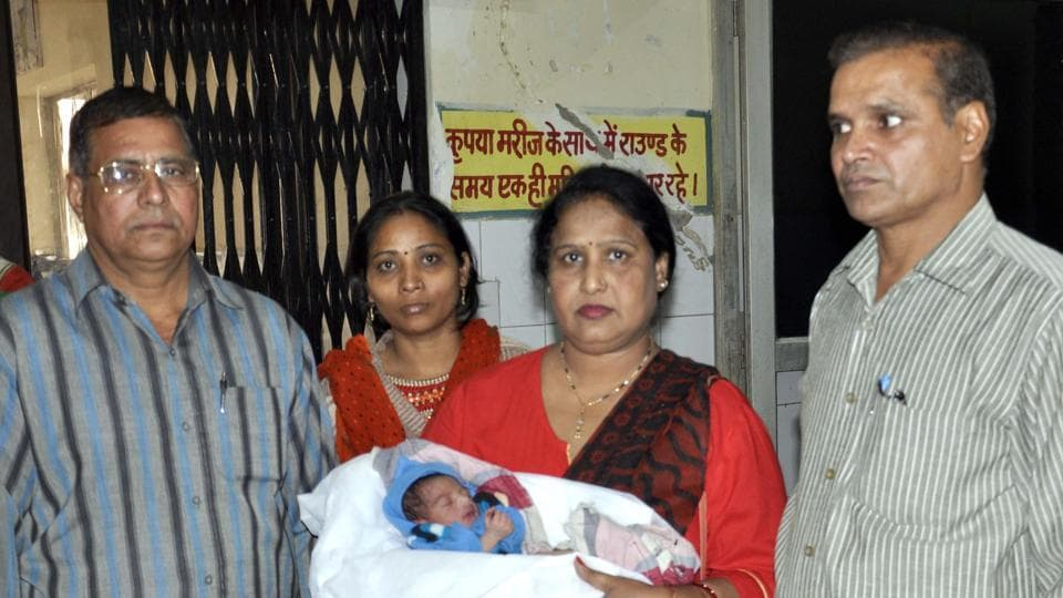 Child welfare committee chairperson Saroj Lohiya with the newborn, in Bharatpur on Saturday.
