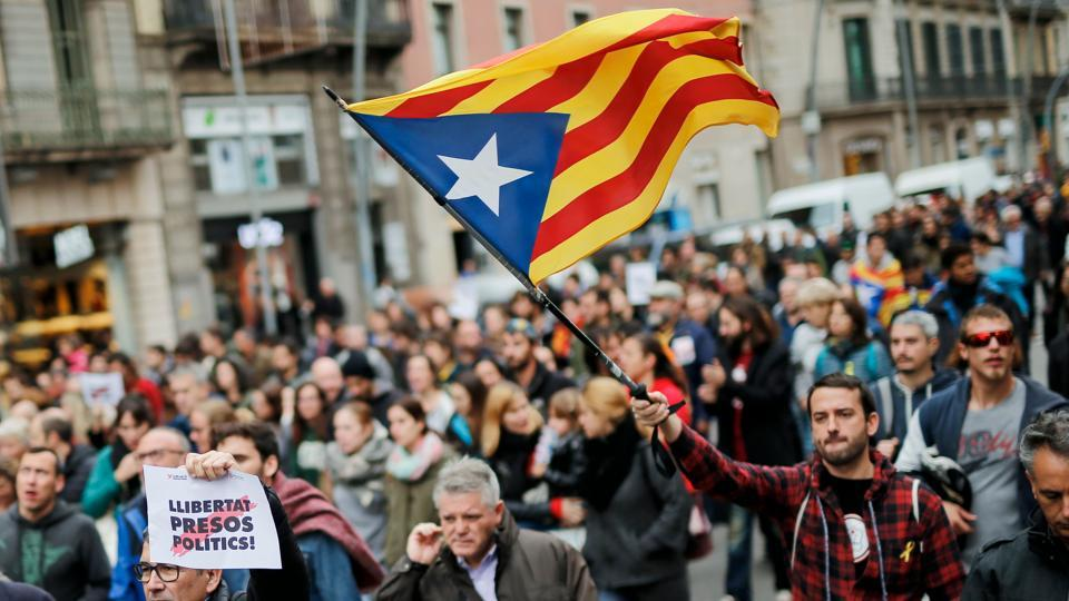 A man holds a Catalan pro-independence 'Estelada' flag in Barcelona on November 8, 2017 during a regionwide strike called by a pro-independence union.