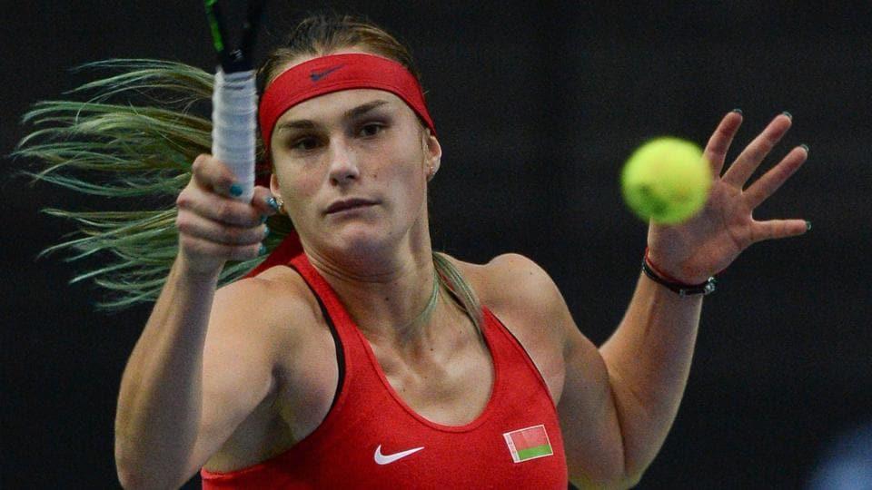Belarus' Aryna Sabalenka returns the ball to Sloane Stephens during their Fed Cup final encounter.