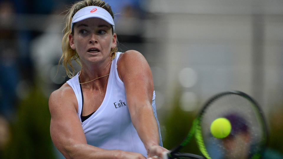 Coco Vandeweghe returns the ball to Belarus' Aliaksandra Sasnovich at the Fed Cup final.
