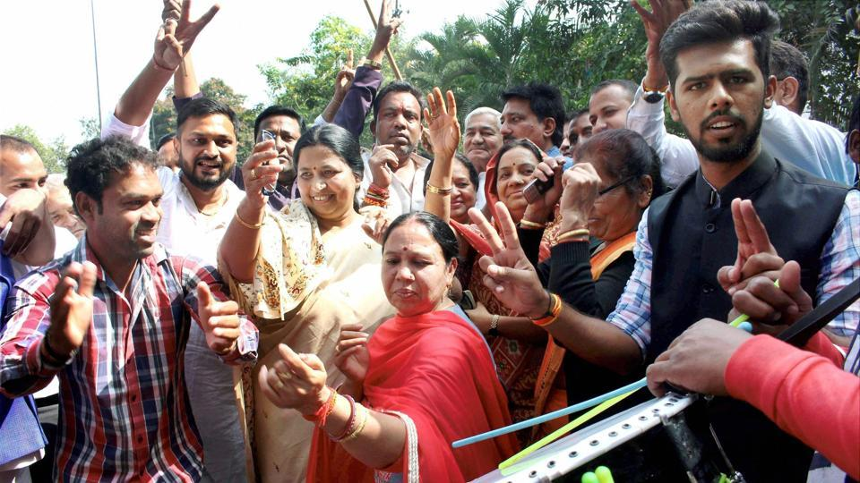 Madhya Pradesh Congress party workers celebrate the party's victory in Chitrakoot bypoll at party headquarters in Bhopal on Sunday.