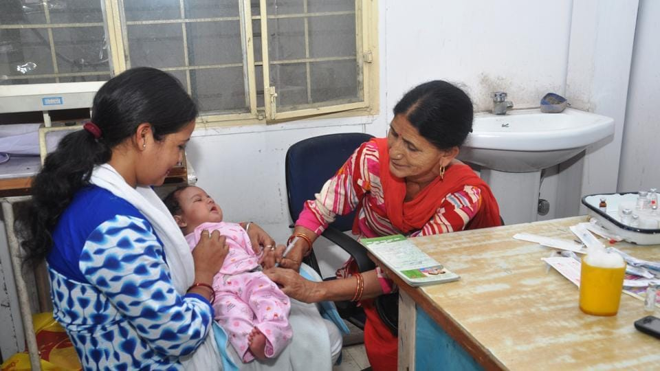 File photo of an infant being given Measles-Rubella vaccine.