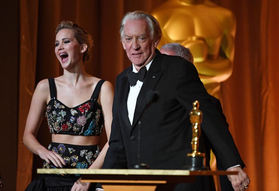 Actress Jennifer Lawrence laughs at a joke as actor Donald Sutherland accepts an honorary Oscar at the 9th Annual Governors Awards gala hosted by the Academy of Motion Picture Arts and Sciences at the Hollywood & Highland Center in Hollywood, California on November 11.