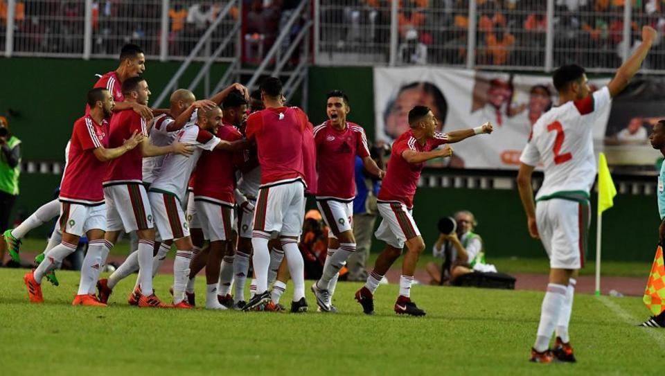 Morocco players celebrate at the Felix Houphouet-Boigny stadium in Abidjan on November 11, 2017, at the end of the FIFA World Cup 2018 Africa Group C qualifying match between Ivory Coast and Morocco. Morocco won 2-0.