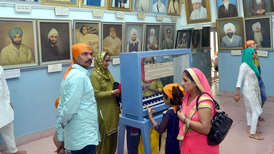 Visitors viewing the paintings and rare items at Central Sikh Museum at Golden Temple in Amritsar on Sunday.