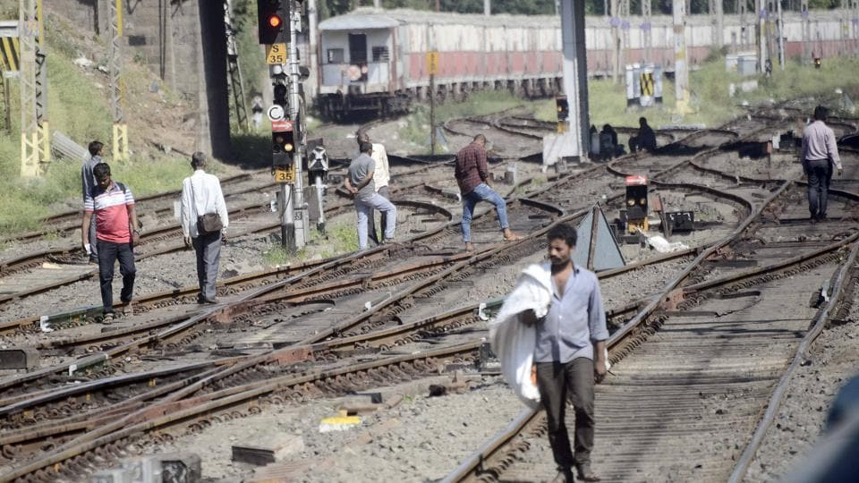 People crossing on the railway tracks at Pune Railway Station.