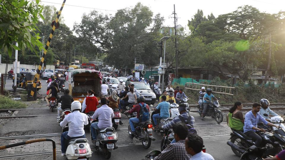 Traffic jams are common at the railway crossing in Ghorpadi as its gates are closed frequently to facilitate the movement of trains.