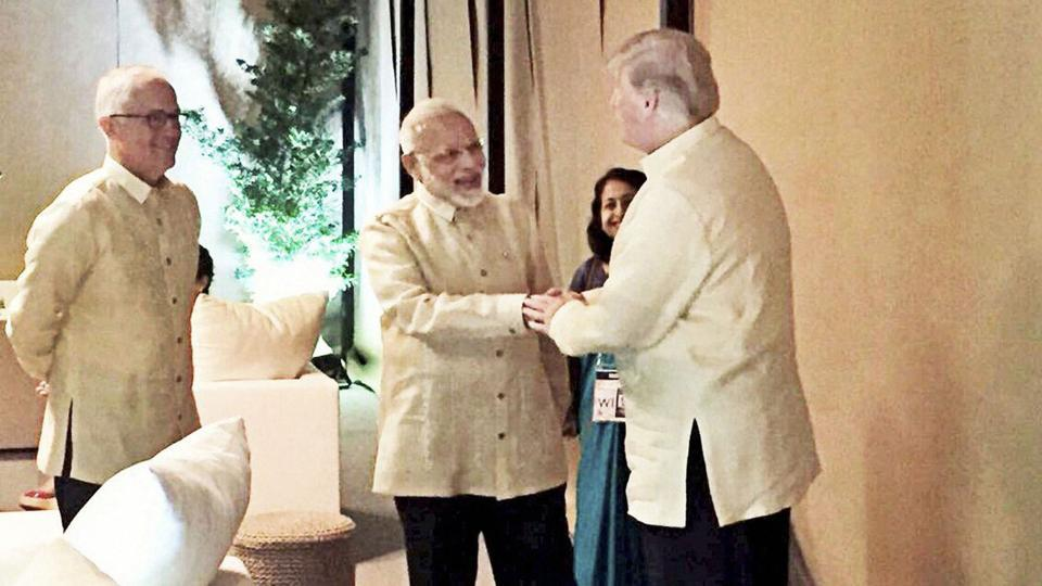 Prime Minister Narendra Modi shakes hands with US President Donald Trump during a meeting in Manila on Sunday.