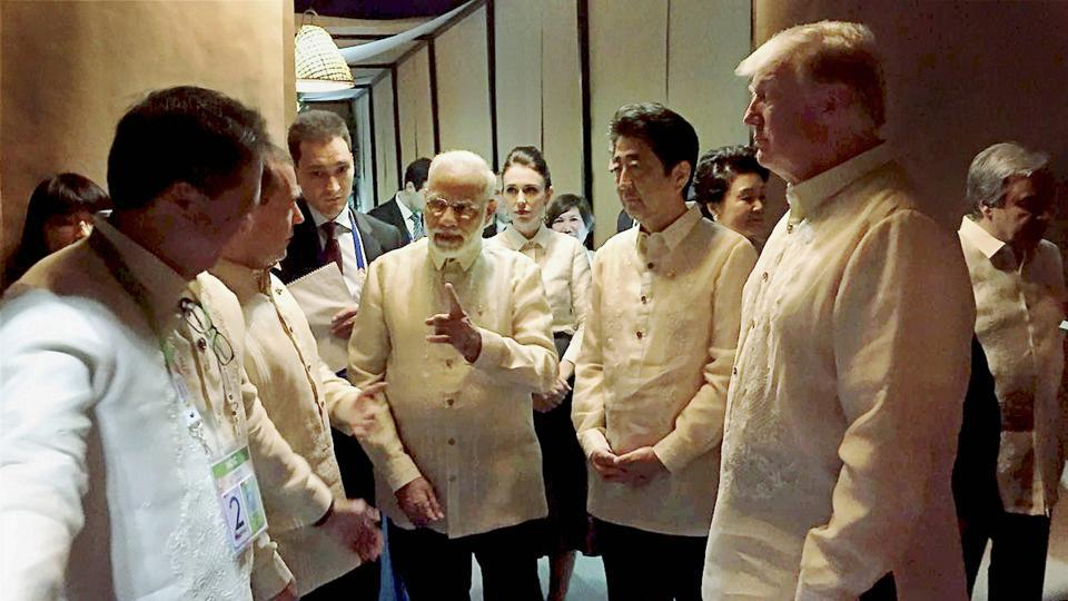 Prime Minister Narendra Modi with US President Donald Trump, Japanese PM Shinzo Abe and other world leaders at an ASEAN Summit dinner in Manila on Sunday.