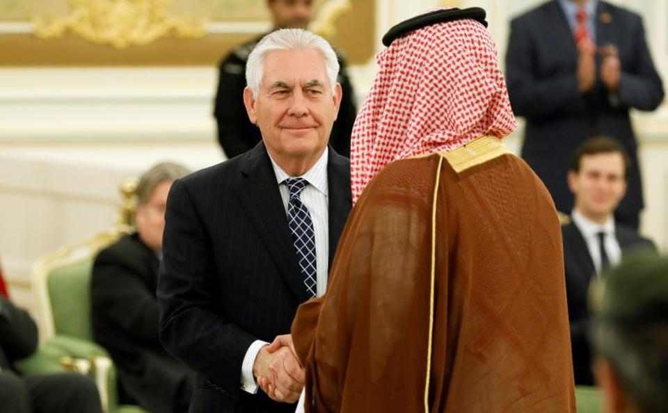 US secretary of state Rex Tillerson shakes hands with a participant during a signing ceremony between President Donald Trump and Saudi Arabia's King Salman bin Abdulaziz Al Saud in Riyadh on May 20, 2017.