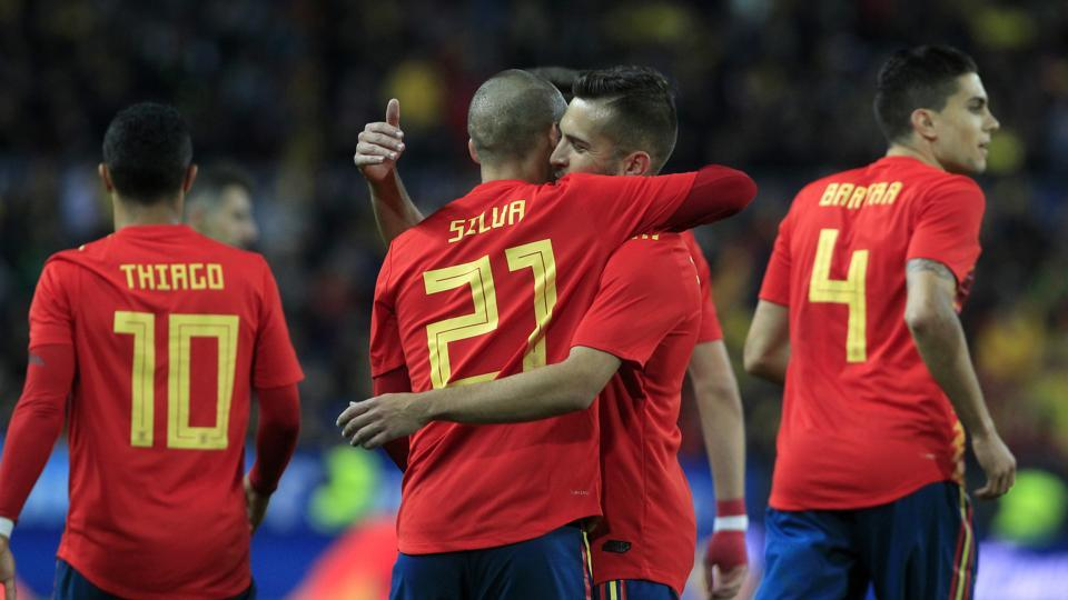 Spain's David Silva is congratulated by teammate Jordi Alba after scoring during the international friendly between Spain and Costa Rica in Malaga. Spain ran out 5-0 winners as Silva scored twice and provided one assist.