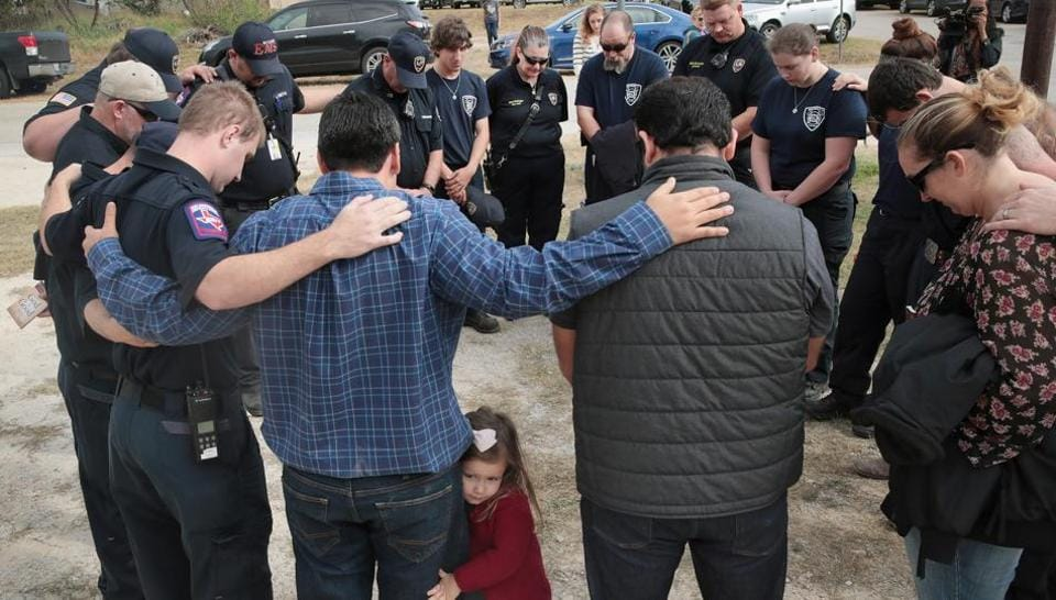 First responders share a prayer following a Veterans Day ceremony outside the Community Center on November 11, 2017 in Sutherland Springs, Texas. The men and women were among the first to enter the First Baptist Church of Sutherland Springs to begin treating the wounded following the shooting on November 5.