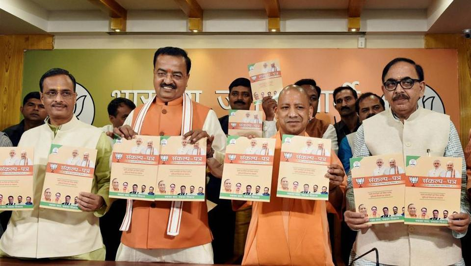 Uttar Pradesh Chief Minister Yogi Aditiyanath with UP BJP President Mahendra Nath Pandey and Dy CMs Keshav Prasad Maurya and Dinesh Sharma releasing the BJP's manifesto for the local bodies elections in Lucknow on Sunday.