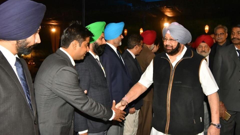 Chief minister Captain Amarinder Singh interacting with police officials at a dinner hosted by him at his residence on Saturday night.