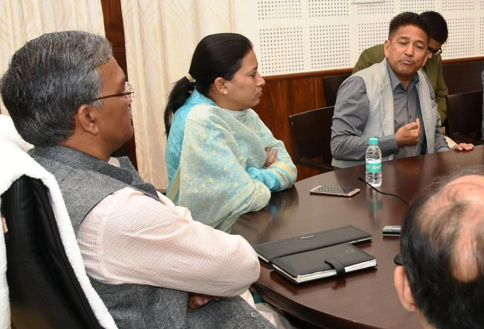 Maj Gen VPS Bhakuni, commandant of the army's selection centre, (1st from R) interacts with chief minister TS Rawat in Dehradun on Monday.